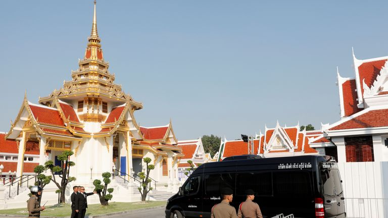 A vehicle carrying the body of Vichai Srivaddhanaprabha arrives at Wat Debsirindrawas temple