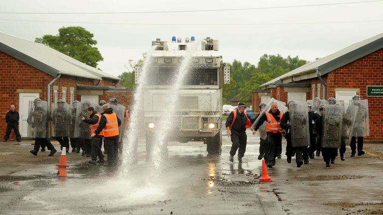Police using a water cannon during training. File pic