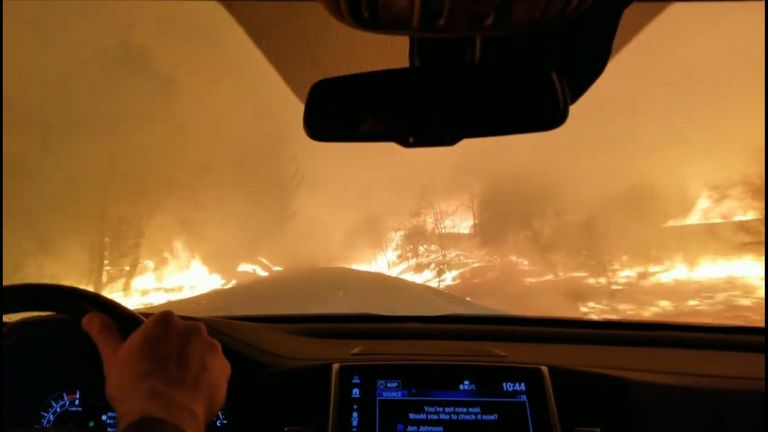 Dramatic footage of family driving through wind driven fire in Paradise, California as thousands of people are urged to flee.