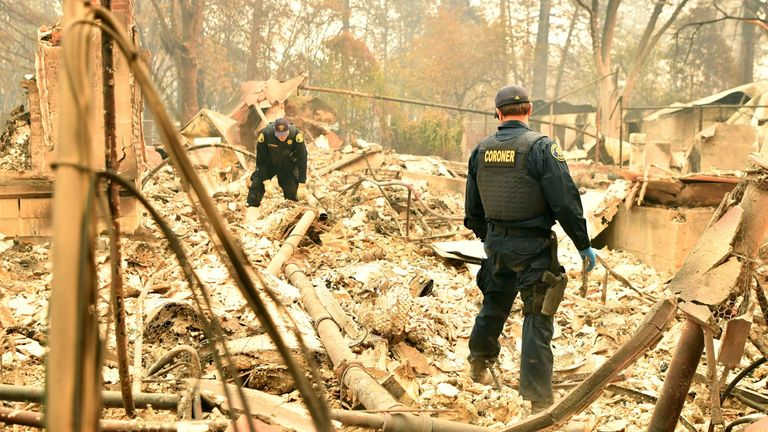 Alameda County Sheriff Coroner officers search for human remains in the town of Paradise
