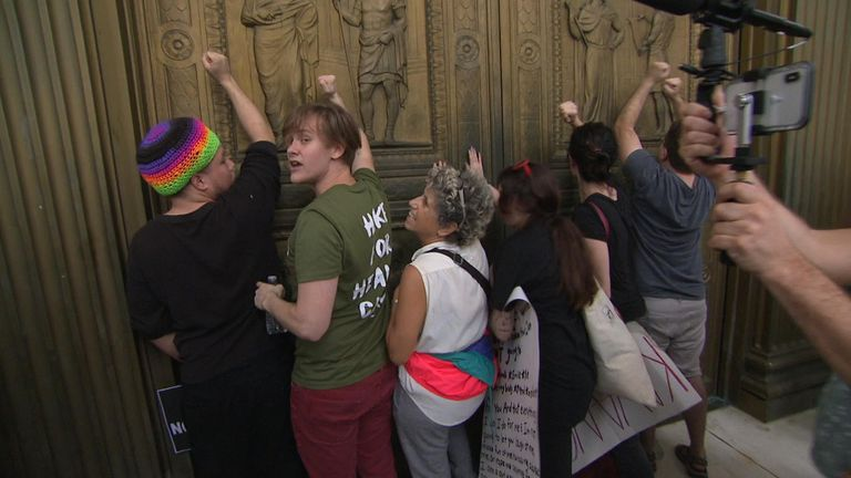 People bang on the door of the Supreme Court to protest against the appointment of Brett Kavanaugh