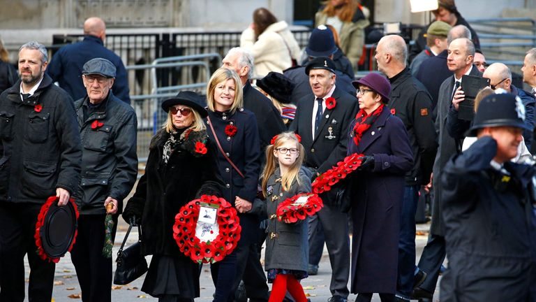 Families take part in a People's Procession after a National Service of Remembrance at The Cenotaph in Westminster, London, Britain, November 11, 2018.