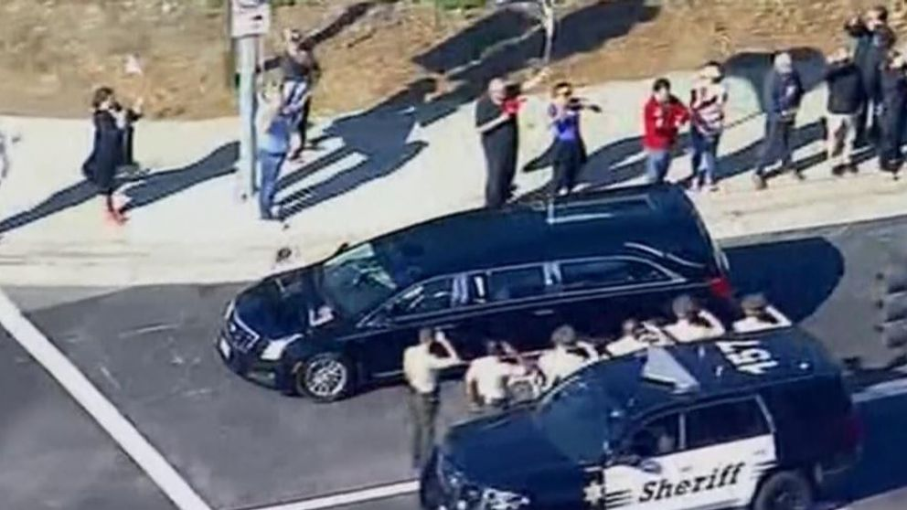 The hearse was saluted by police as it passed by