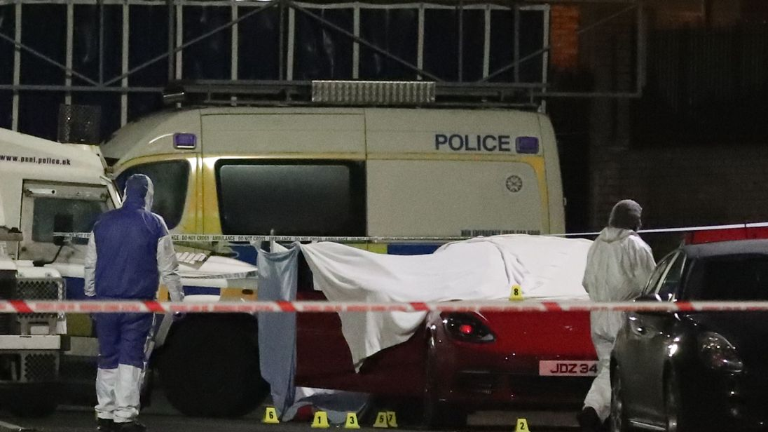 Forensic officers at the scene of the shooting in Belfast