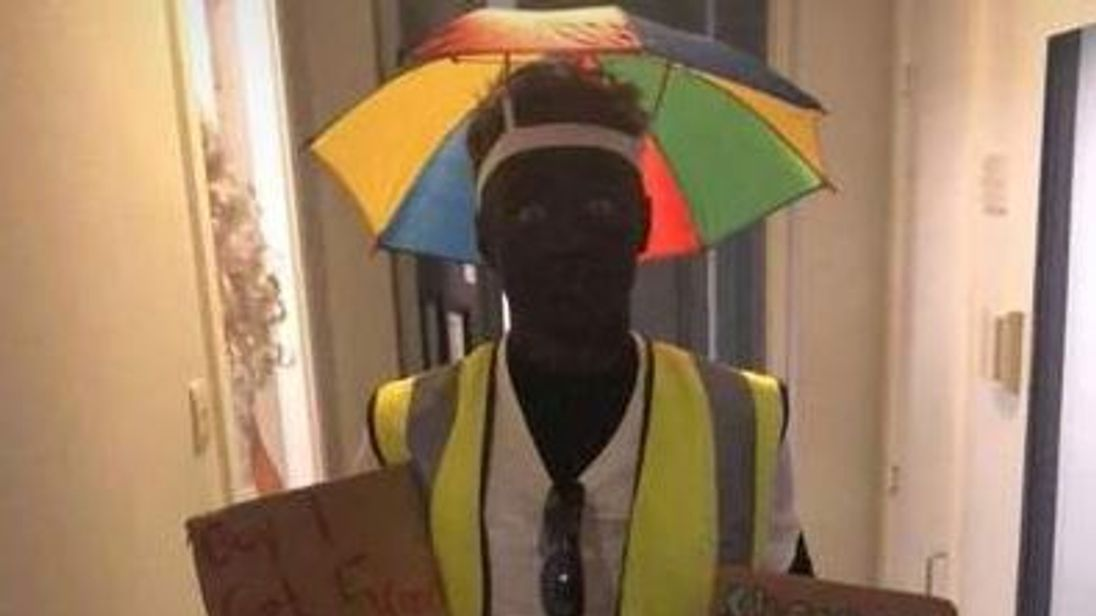 A footballer has been disciplined after he painted his face black for a fancy dress party earlier this month.