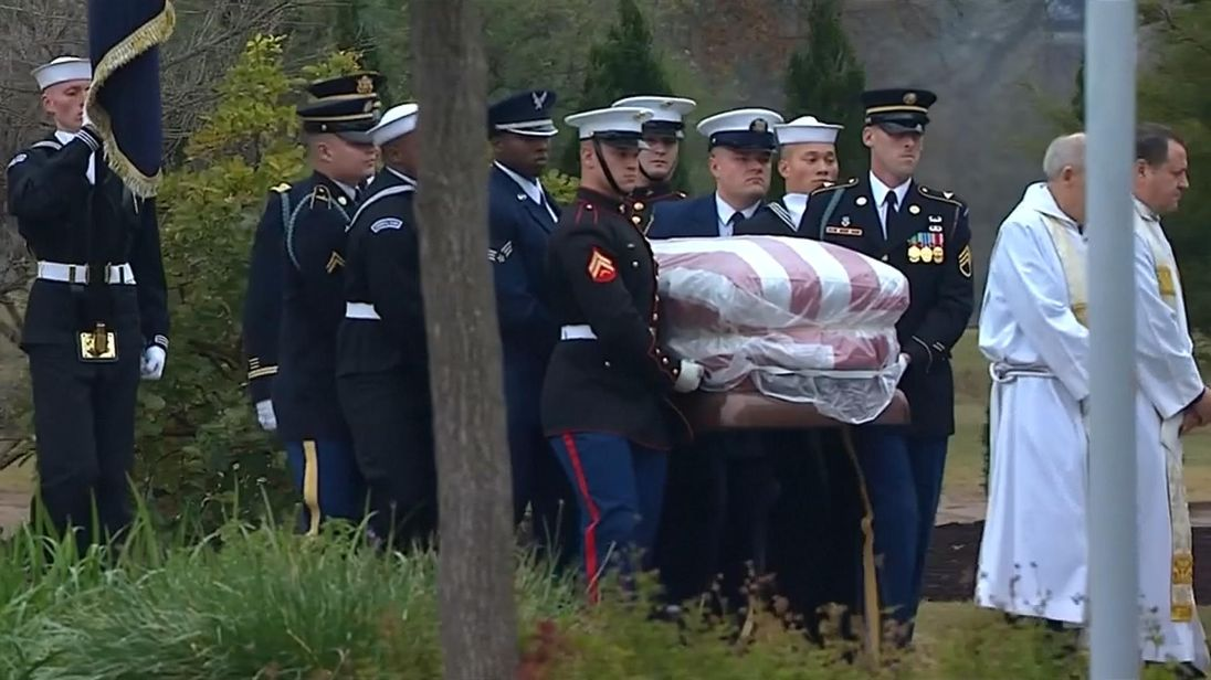 The coffin of George H.W. Bush carried by a guard of honour