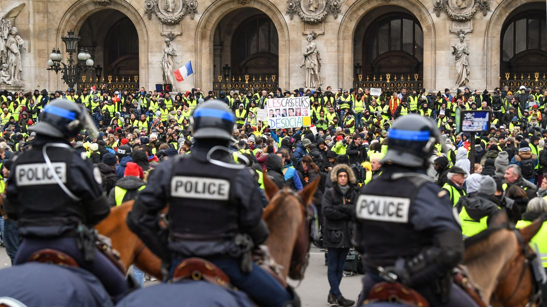 Protesters gather at Place de l' Opera during the 'yellow vests' demonstration on December 15, 2018 in Paris, France