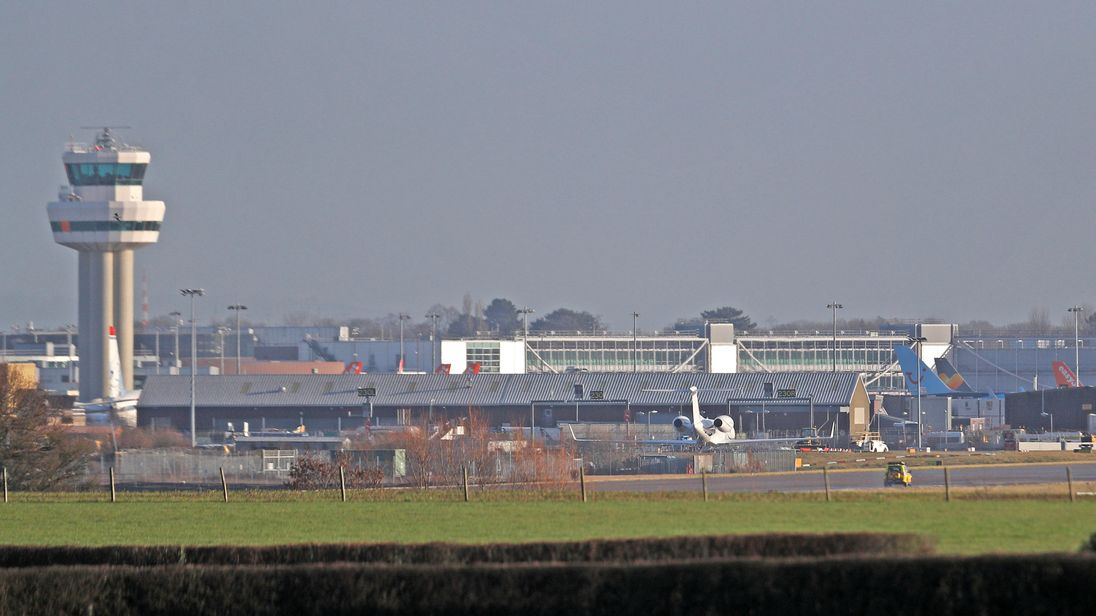 A police vehicle stands on the closed runway at Gatwick Airport after drones flying illegally over the airfield forced the closure of the airport