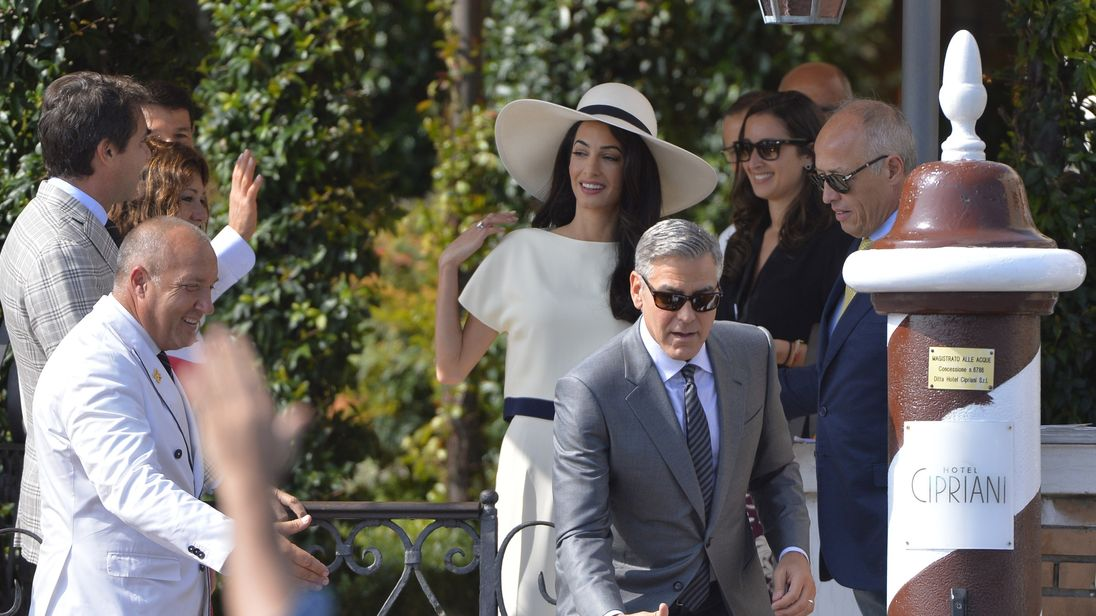 George and Amal Clooney leave the Hotel Cipriani on September 29, 2014 in Venice, before a civil ceremony to legalize their wedding.