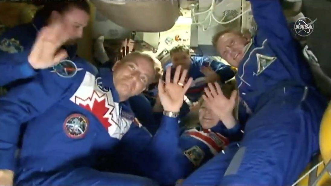 The astronauts waved after being reunited with fellow crew members aboard the ISS. Pic: NASA