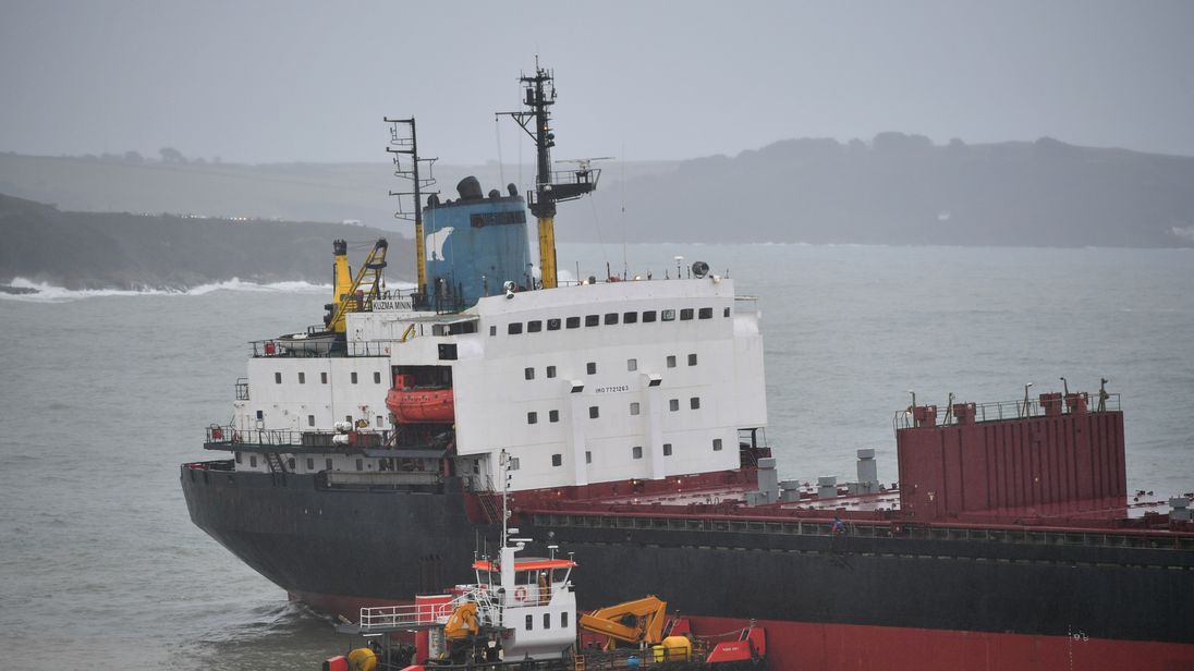 A tug boat works to help refloat the Kuzma Mini