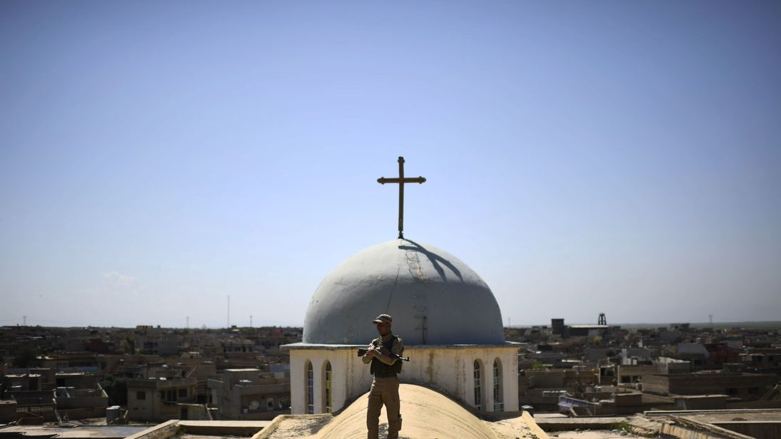 A Syriac Christian militiaman guards a church in the Iraqi town of Qaraqosh