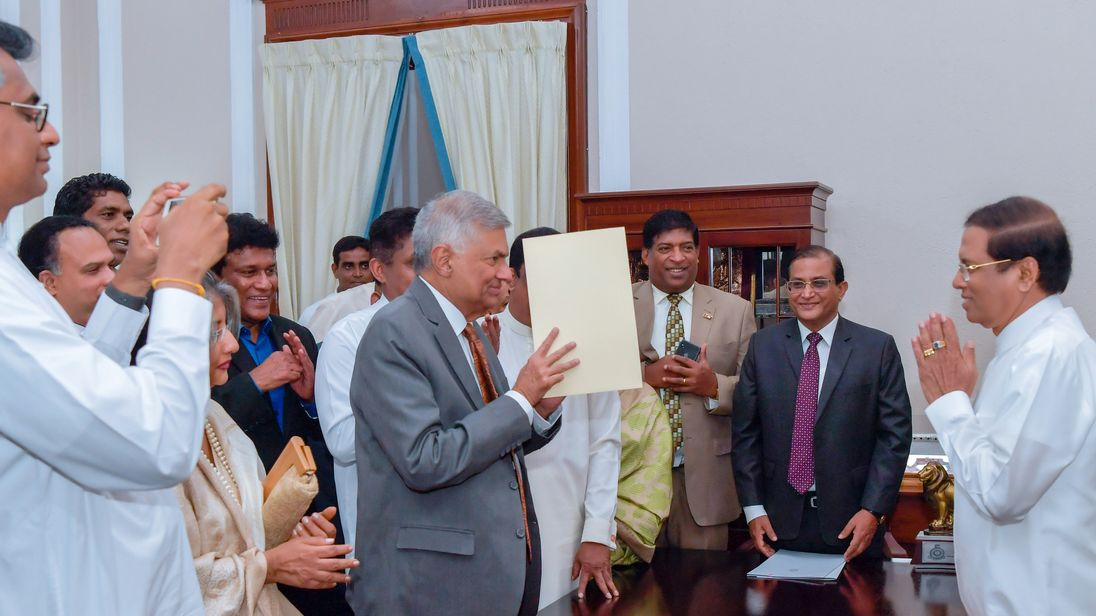 Ranil Wickremesinghe takes his oath before Maithripala Sirisena weeks after being ousted by him