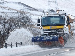 A snow plough clears the A9 near Dalwhinnie, Scotland, Britain December 16, 2018