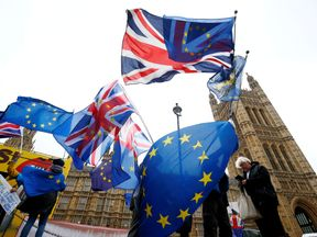 Demonstrators protest against Brexit outside the Houses of Parliament