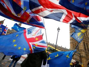 Demonstrators protest against Brexit outside the Houses of Parliament in London