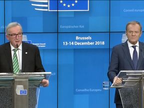 Jean-Claude Juncker and Donald Tusk at a news conference in Brussels