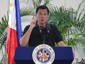 Philippines President Rodrigo Duterte delivers a speech at the Davao international airport terminal building early on September 30, 2016, shortly after arriving from an official visit to Vietnam. Duterte on September 30 drew a parallel with his deadly crime war and Hitler's massacre of Jews, as he said he was 'happy to slaughter' millions of drug addicts. / AFP / MANMAN DEJETO (Photo credit should read MANMAN DEJETO/AFP/Getty Images)