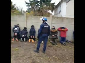Children forced to kneel by riot police