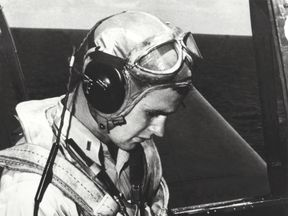 George H W Bush is pictured in the cockpit of his TBM Avenger during the World War Two