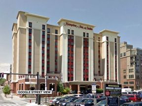 The woman says she was filmed in the shower of the Hampton Inn and Suites in downtown Albany, NY