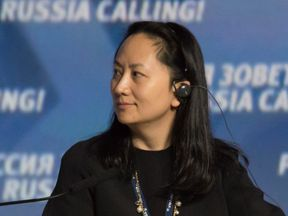 "Meng Wanzhou, Executive Board Director of the Chinese technology giant Huawei, attends a session of the VTB Capital Investment Forum ""Russia Calling!"" in Moscow, Russia October 2, 2014. Picture taken October 2, 2014"