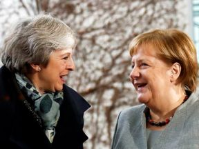 Theresa May is welcomed by Angela Merkel at the Chancellery in Berlin