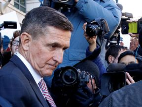 Michael Flynn leaves court after hearing his sentencing has been delayed