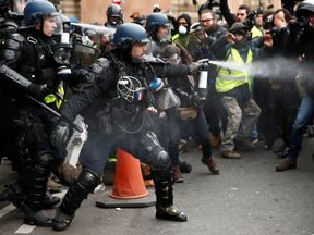 Police use pepper spray to push protesters back in Paris