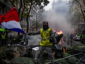 Protesters wore 'gilets jaunes' as large parts of the capital were shut down