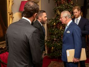 Prince Charles speaks with the actor Tom Hardy at the Clarence House event