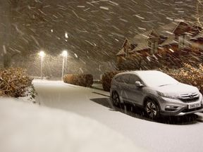 Snow falls in the Scottish Borders as Storm Deirdre hit the British Isles bringing plunging temperatures and treacherous traffic conditions
