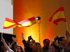 Supporters of Spain's far-right VOX party celebrate results after the Andalusian regional elections in Seville