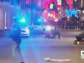 Victims of gunman being treated while lying on the ground