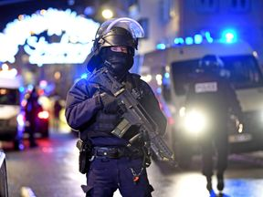A police officer stands guard near the Christmas market where a deadly shooting took place in Strasbourg, France