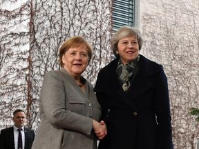 Theresa May is welcomed by German Chancellor Angela Merkel at the chancellery in Berlin