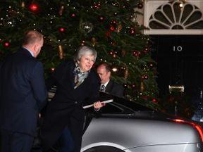 Prime Minister Theresa May arrives back at 10 Downing Street, London, as Conservative MPs hold a vote of confidence in her leadership. PRESS ASSOCIATION Photo. Picture date: Wednesday December 12, 2018. See PA story POLITICS Brexit. Photo credit should read: Victoria Jones/PA Wire