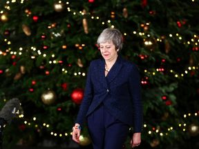 Theresa May says she will listen to her critics following the confidence vote