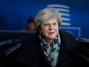 Theresa May arrives on December 14, 2018 in Brussels during the second day of a European summit