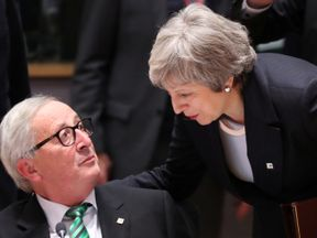Theresa May and Jean-Claude Juncker at the summit in Brussels