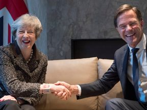 Theresa May and Dutch Prime Minister Mark Rutte at the start of a meeting in the Hague