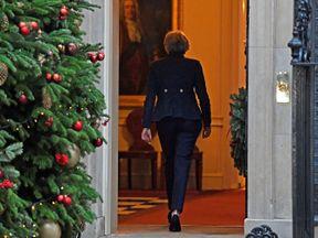 Theresa May walks back into 10 Downing Street