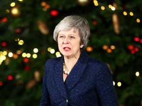 Theresa May speaks outside 10 Downing Street after a confidence vote by Conservatives