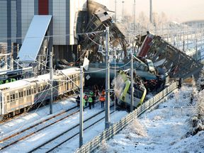 Rescue workers search at the wreckage after a high speed train crash in Ankara, Turkey