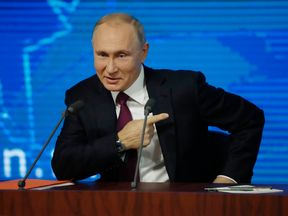 Vladimir Putin speaks during annual news conference in Moscow
