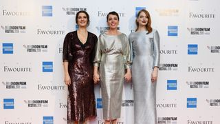 The three leading ladies in The Favourite pose on the red carpet