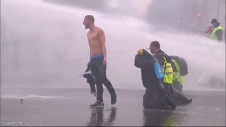 "French riot police fired tear gas and water cannon at ""yellow vest"" protesters breaching a cordon before rally against high fuel prices."