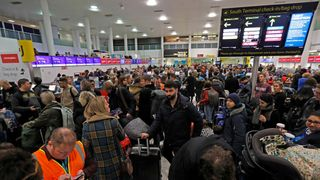 Passengers wait around in the South Terminal building at Gatwick Airport
