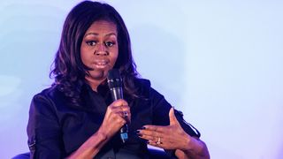 Former US First Lady Michelle Obama speaks at an event at the Elizabeth Garrett Anderson School