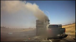 Dramatic footage captures the moment a sheriff deputy rescues a man from a burning truck in Terrel, Texas.